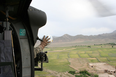 U.S. soldiers run mission Operation Soccer Chopper as they deliver soccer balls to  Afghan kids from their Black Hawk helicopter.