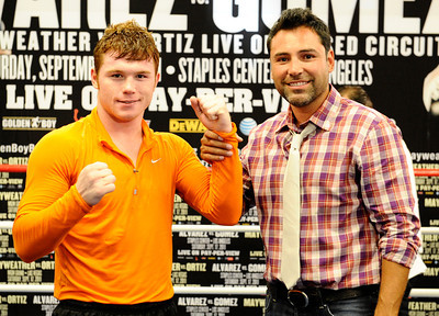 (R)Former profesional boxer and promoter Oscar De La Hoya poses with Mexico's Canelo Alvarez, as Oscar made his first public appearance after being in rehab for several months. Oscar De La Hoya has fully recovered from his substance abuse and is back to promote boxing with his company Golden Boy Productions that has two big fights coming up in Los Angeles and Las Vegas on September 17th. Big Bear Lake, CA. Aug 23, 2011.photo by Gene Blevins/LA DAILY NEWS