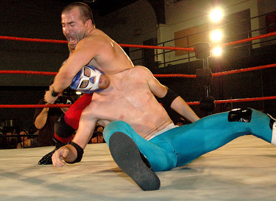 """Tony Kozina hits El Generico during their match at the second night of Pro Wrestling Guerrilla's """"Battle of Los Angeles"""" at the National Guard Armory in Burbank, California on Saturday Sept.  1, 2007. (Shane Michael Kidder / Staff)"""