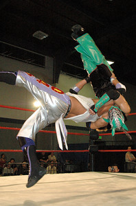 """Susumu Yokosuka hits an northern lights suplex on Dragon Kid during their match at the second night of Pro Wrestling Guerrilla's """"Battle of Los Angeles"""" at the National Guard Armory  in Burbank, California on Saturday Sept.  1, 2007. (Shane Michael Kidder / Staff)"""