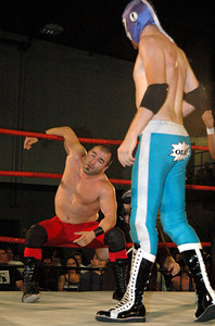 """Tony Kozina uses the ropes to help him stand during his match at the second night of Pro Wrestling Guerrilla's """"Battle of Los Angeles"""" at the National Guard Armory in Burbank, California on Saturday Sept.  1, 2007.  (Shane Michael Kidder / Staff)"""