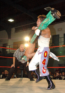 """Dragon Kid hits a leg scissors on  Susumu Yokosuka during their match at the second night of Pro Wrestling Guerrilla's """"Battle of Los Angeles"""" at the National Guard Armory in Burbank, California on Saturday Sept.  1, 2007. (Shane Michael Kidder / Staff)"""