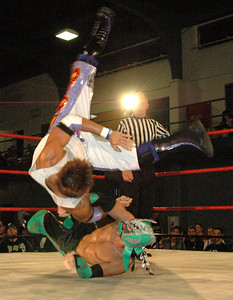 """Dragon Kid hits an arm drag  on  Susumu Yokosuka during their match at the second night of Pro Wrestling Guerrilla's """"Battle of Los Angeles"""" at the National Guard Armory in Burbank, California on Saturday Sept.  1, 2007. (Shane Michael Kidder / Staff)"""