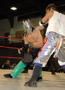 """Susumu Yokosuka has a arm bar on Dragon Kid during their match at the second night of Pro Wrestling Guerrilla's """"Battle of Los Angeles"""" at the National Guard Armory  in Burbank, California on Saturday Sept.  1, 2007. (Shane Michael Kidder / Staff)"""