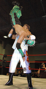 """Susumu Yokosuka has  Dragon Kid up for a suplex during their match at the second night of Pro Wrestling Guerrilla's """"Battle of Los Angeles"""" at the National Guard Armory  in Burbank, California on Saturday Sept.  1, 2007. (Shane Michael Kidder / Staff)"""