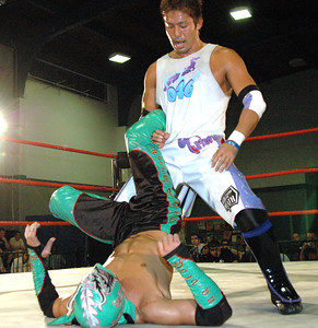 """Susumu Yokosuka has a submission move on Dragon Kid during their match at the second night of Pro Wrestling Guerrilla's """"Battle of Los Angeles"""" at the National Guard Armory  in Burbank, California on Saturday Sept.  1, 2007. (Shane Michael Kidder / Staff)"""