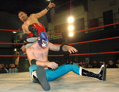 """Tony Kozina hits a dropkick on El Generico during their match at the second night of Pro Wrestling Guerrilla's """"Battle of Los Angeles"""" at the National Guard Armory in Burbank, California on Saturday Sept.  1, 2007. (Shane Michael Kidder / Staff)"""