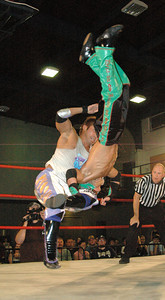 """Susumu Yokosuka hits an reverse power slam on Dragon Kid during their match at the second night of Pro Wrestling Guerrilla's """"Battle of Los Angeles"""" at the National Guard Armory  in Burbank, California on Saturday Sept.  1, 2007. (Shane Michael Kidder / Staff)"""
