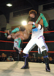 """Dragon Kid attempts a Hurracarrana  on  Susumu Yokosuka during their match at the second night of Pro Wrestling Guerrilla's """"Battle of Los Angeles"""" at the National Guard Armory in Burbank, California on Saturday Sept.  1, 2007. (Shane Michael Kidder / Staff)"""