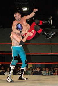 """Tony Kozina hits a Flying Bulldog on El Generico  during their match at the second night of Pro Wrestling Guerrilla's """"Battle of Los Angeles"""" at the National Guard Armory  in Burbank, California on Saturday Sept.  1, 2007. (Shane Michael Kidder / Staff)"""