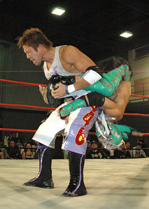 """Dragon Kid attempts a sunset flip  on  Susumu Yokosuka during their match at the second night of Pro Wrestling Guerrilla's """"Battle of Los Angeles"""" at the National Guard Armory  in Burbank, California on Saturday Sept.  1, 2007. (Shane Michael Kidder / Staff)"""