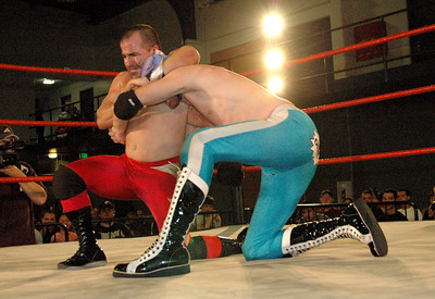 """Tony Kozina has a headlock on El Generico during their match at the second night of Pro Wrestling Guerrilla's """"Battle of Los Angeles"""" at the National Guard Armory in Burbank, California on Saturday Sept.  1, 2007. (Shane Michael Kidder / Staff)"""