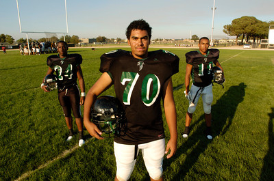 Palmdale High School Football players front Connor Bradford-back left Ronald Scott and Malcomb Culver.