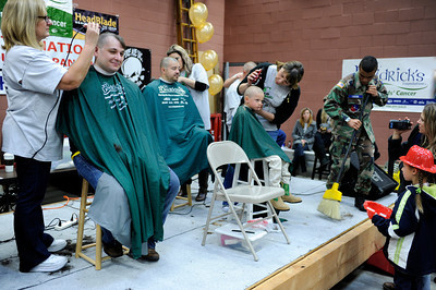 People get their heads shaved during the St. BaldrickÕs Foundation Head-Shaving Event at LAFD Fire Station 89 in North Hollywood Saturday, March 17, 2012. The event was anticipated to raise $100,000 with more than 200 participants registered with proceeds going to children's cancer. (Hans Gutknecht/Staff Photographer)