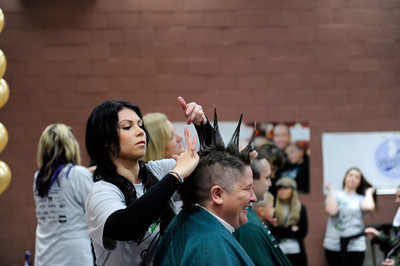 LAPD dispatcher Shawnie Livera gets a mohawk by hairdresser Lauren Silva during the St. BaldrickÕs Foundation Head-Shaving Event at LAFD Fire Station 89 in North Hollywood Saturday, March 17, 2012. The event was anticipated to raise $100,000 with more than 200 participants registered with proceeds going to children's cancer. (Hans Gutknecht/Staff Photographer)