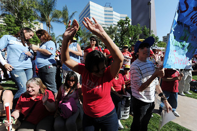 Woodlawn Ave. Elementary School teacher Angelica M. Del Torre dances during a protest to state cuts to education at Pershing Square in Los Angeles Friday, May 13, 2011. (Hans Gutknecht/Staff Photographer)