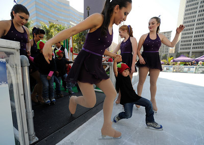 Some kids were a bit wobbly when they first entered the ice. Pershing Square has been transformed into a partial winter wonderland as the 14th annual Downtown On Ice Holiday Rink was opened Thursday Morning, 11/17/2011.  Olympic Champion Tara Lipinski, Mayor Antonio Villaraigosa, a skating Snoopy and girls from the Los Angeles Ice Theater Youth Ensemble welcomed Children from San Pedro Street Elementary and Sheenway School and Cultural Center to be the first to take to the ice for the holiday season. The rink will be open everyday, including holidays through January 16, 2012. The charge to skate is $6 plus an additional $2 if you need to rent skates. Los Angeles, CA. 11/17/2011(John McCoy/Staff Photographer)