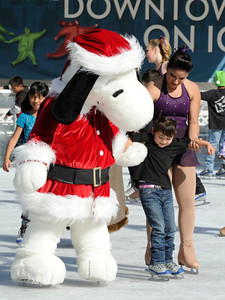 Pershing Square has been transformed into a partial winter wonderland as the 14th annual Downtown On Ice Holiday Rink was opened Thursday Morning, 11/17/2011.  Olympic Champion Tara Lipinski, Mayor Antonio Villaraigosa, a skating Snoopy and girls from the Los Angeles Ice Theater Youth Ensemble welcomed Children from San Pedro Street Elementary and Sheenway School and Cultural Center to be the first to take to the ice for the holiday season. The rink will be open everyday, including holidays through January 16, 2012. The charge to skate is $6 plus an additional $2 if you need to rent skates. Los Angeles, CA. 11/17/2011(John McCoy/Staff Photographer)