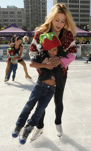 Olympic Champion figure skater Tara Lipinski helps Anayeli Morales,5, while out on the ice. Pershing Square has been transformed into a partial winter wonderland as the 14th annual Downtown On Ice Holiday Rink was opened Thursday Morning, 11/17/2011.   Lipinski, Mayor Antonio Villaraigosa, a skating Snoopy and girls from the Los Angeles Ice Theater Youth Ensemble welcomed Children from San Pedro Street Elementary and Sheenway School and Cultural Center to be the first to take to the ice for the holiday season. The rink will be open everyday, including holidays through January 16, 2012. The charge to skate is $6 plus an additional $2 if you need to rent skates. Los Angeles, CA. 11/17/2011(John McCoy/Staff Photographer)