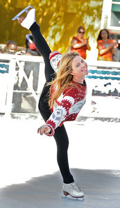 Tara Lipinski skates. Pershing Square has been transformed into a partial winter wonderland as the 14th annual Downtown On Ice Holiday Rink was opened Thursday Morning, 11/17/2011.  Olympic Champion Tara Lipinski, Mayor Antonio Villaraigosa, a skating Snoopy and girls from the Los Angeles Ice Theater Youth Ensemble welcomed Children from San Pedro Street Elementary and Sheenway School and Cultural Center to be the first to take to the ice for the holiday season. The rink will be open everyday, including holidays through January 16, 2012. The charge to skate is $6 plus an additional $2 if you need to rent skates. Los Angeles, CA. 11/17/2011(John McCoy/Staff Photographer)