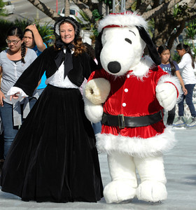 Sharilyn Christensen skates along with Snoopy. Pershing Square has been transformed into a partial winter wonderland as the 14th annual Downtown On Ice Holiday Rink was opened Thursday Morning, 11/17/2011.  Olympic Champion Tara Lipinski, Mayor Antonio Villaraigosa, a skating Snoopy and girls from the Los Angeles Ice Theater Youth Ensemble welcomed Children from San Pedro Street Elementary and Sheenway School and Cultural Center to be the first to take to the ice for the holiday season. The rink will be open everyday, including holidays through January 16, 2012. The charge to skate is $6 plus an additional $2 if you need to rent skates. Los Angeles, CA. 11/17/2011(John McCoy/Staff Photographer)