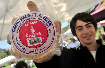 Persian Club member Arbi Hovspian sold Persian ice cream sandwiches. The Persian Student Association at Glendale Community College held a Nowruz Bazaar to celebrate the Persian New Year that arrives on Sunday March 20 at exactly 4:15 PM.  The festival included booths with displays of Persian art and a Haft-seen table set with the seven articles that represent life, heath, happiness, prosperity, love, joy and beauty. Other booths will featured a tea house, hand crafts, musical instruments, Persian pastries and other food. Glendale , CA. 3-9-2011. (John McCoy/staff photographer)