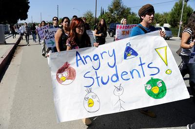 Pierce College students and faculty march down Victory Blvd. during a rally at the Woodland Hills community college. The rally and march were held to protest the 400 million dollars that has been cut from California Community Colleges in the past year and proposed fee hikes.  (Hans Gutknecht/Staff Photographer)