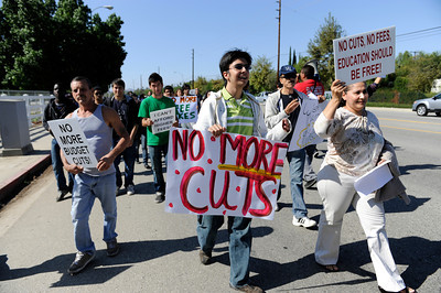 Students and faculty march down Victory Blvd. during a rally at the Woodland Hills community college. The rally and march were held to protest the 400 million dollars that has been cut from California Community Colleges in the past year and proposed fee hikes.  (Hans Gutknecht/Staff Photographer)