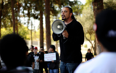 Pierce College Professor James McKeever speaks during a rally at the Woodland Hills community college. The rally and march were held to protest the 400 million dollars that has been cut from California Community Colleges in the past year and proposed fee hikes.  (Hans Gutknecht/Staff Photographer)