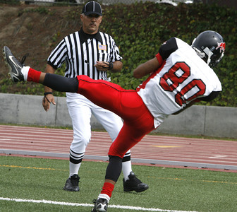 Pierce's Robert Skinner catches a pass for a touchdown  in front of the referee on Saturday, Oct. 13, 2007 against West Los Angeles College. (Edna T. Simpson)