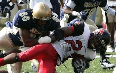 Pierce's Brandon Turner gets tackled by West Los Angeles Sherrard Lewis during the second half on Saturday, Oct. 13, 2007 (Edna T. Simpson)