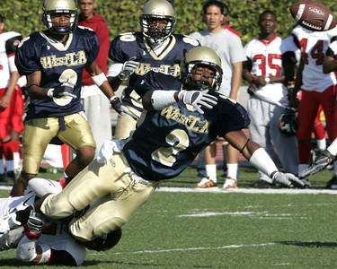 West Los Angeles' Trason Bragg dives to turf  in process of gaining possession of ball during the second half on Saturday,7, Oct. 2007. (Edna T. Simpson)