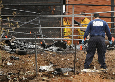 AGUA DULCE — Investigators look over a small plane crashed and burst into flames Thursday, Oct. 21, 2010 in a horse corral in northern Los Angeles County, killing three people and three horses, a fire official said. (Gene Blevins/Special to the Daily News)