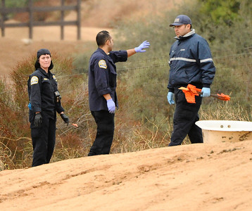 AGUA DULCE — Investigators look over the scene where small plane crashed into a horse corral and burst into flames Thursday, Oct 21, 2010 in this northern Los Angeles County town, killing three people and three horses.(Gene Blevins/Special to the Daily News)
