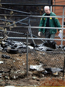 Investigators work the scene Thursday, Oct. 21, 2010 in Agua Dulce where a small plane crashed into a horse corral and burst into flames, killing three people and three horses in the northern L.A. County town. (Gene Blevins/Special to the Daily News)