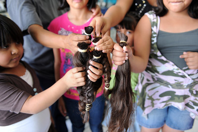 Maria Carrillo is hoping to collect 100 donations of ponytails that will make a wig for those with cancer. So far she has 70 collected mostly from Morningside Elementary School students. (Hans Gutknecht/Staff Photographer)