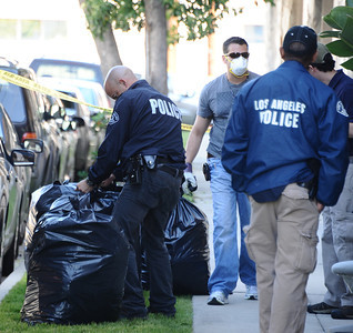 Law-enforcement agents seeking evidence of illicit marijuana cultivation and related crime were searching residences and warehouses this morning in Los Angeles County, mostly in the San Fernando Valley, according to an FBI spokeswoman.  Agents were executing search warrants in North Hollywood, North Hills, Sherman Oaks and Canoga Park - among other communities - said the FBI's Laura Eimiller.  The FBI led the operation, which included the LAPD, the Drug Enforcement Administration, and U.S. Immigration and Customs Enforcement. North Hills, CA. March 30,2011. Photo by Gene Blevins/LA Daily News