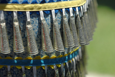 Bells are sewn into the costume of an Indian dancer. Native American Indians from a variety of tribes gathered together at Moorpark College for a powwow. Sacred dances were performed by Indians dressed in the traditional regalia from their tribes. Vendors were also on hand to sell native American inspired jewelry and artworks.  Moorpark, CA 07/17/2010 (John McCoy/Staff Photographer)