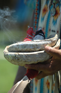 The purifying smoke from burning sage rises from an abalone shell before dances begin. Native American Indians from a variety of tribes gathered together at Moorpark College for a powwow. Sacred dances were performed by Indians dressed in the traditional regalia from their tribes. Vendors were also on hand to sell native American inspired jewelry and artworks.  Moorpark, CA 07/17/2010 (John McCoy/Staff Photographer)