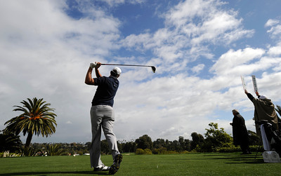 Beautiful fluffy clouds hand above the first fairway as Bo Van Pelt tees off during the Wednesday Pro Am at Riviera Country Club, one day before the start of the Northern Trust Open. Pacific Palisades, CA 2/15/2012(John McCoy/Staff Photographer)