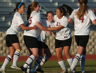 2-22-06 - Oaks Christian High School's Megan Schoppe, center, is congratulated by teammates after scoring the game's only goal in overtime to beat Paraclete High School 1-0 during a playoff game at Oaks Christian. (Michael Owen Baker/LA Daily News Staff Photographer)