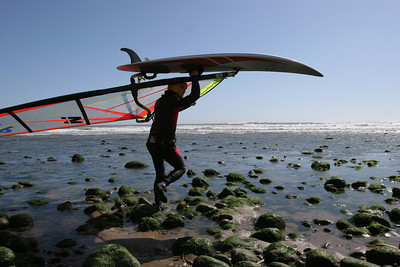 3-7-06- Chang Liampetchakul, of Ventura, carries his windsurfer to the water to take advantage of the strong winds at Surfer's Point in Ventura. (Michael Owen Baker/LA Daily News Staff Photographer)