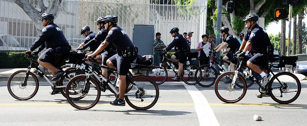 LAPD bike patrol watches a crowd of 100 people as they march to demand justice for Manuel Jamines, the Guatemalan immigrant who was shot by L.A. police Sept. 5. Two groups of protesters gathered 6th Street and Union at the LAPD Rampart Div. and then march to downtown LAPD station and MacArthur Park. Los Angeles CA..Sept 18,2010. Photo by Gene Blevins/LA Daily News