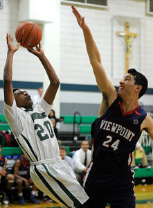 Providence#20 Marcus LoVett Jr. goes to the hoop against Viewpoint#24 John Walsh. Providence High School defeated Viewpoint 85 to 67 in a Boys Basketball Liberty League showdown for first place. Burbank CA 1/24/2012(John McCoy/Staff Photographer)