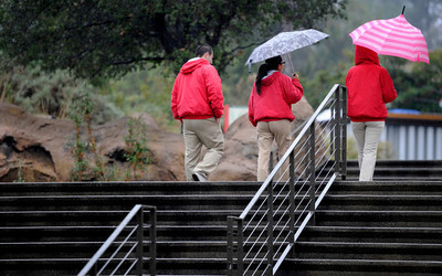 Two out of three people arriving at the Los Angeles Zoo thought that it was a good idea to use an umbrella. Los Angeles CA 1/21/2012(John McCoy/Staff Photographer)