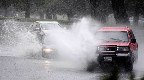 Drivers speeding around the Sepulveda Basin make huge waves through flooded areas as heavy bands of rain moved across Los Angeles County, and triggered warnings from the National Weather Service of possible localized ponding and flooding across the Southland.  Van Nuys CA.March 25.2012. Photo by Gene Blevins/LA Daily News