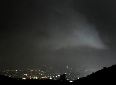 Huge storm clouds pass over Los Angeles as rain moved across Los Angeles County, and triggered warnings from the National Weather Service of possible localized ponding and flooding across the Southland. Los Angeles CA.March 25.2012. Photo by Gene Blevins/LA Daily News