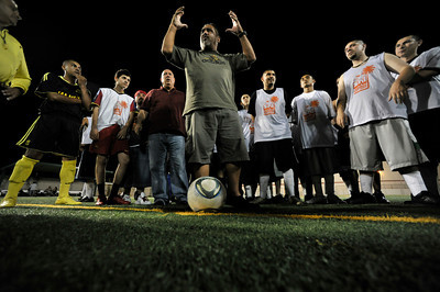 Pastor Rudy Trujillo, form the Faith Center in San Fernando, speaks to the group before the game. A soccer match between Sun Valley Parks Vineland Boys, and Delano Parks, Barrio Van Nuys, was played at Delano Park during the Summer Night Lights program. The rival gangs decided to leave their differences behind them, and play a spirited game of soccer.  Van Nuys CA. 8-24-2011. (John McCoy/Staff Photographer)