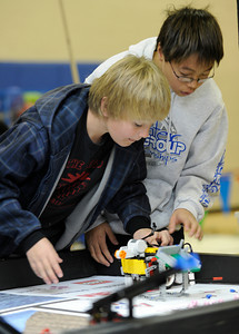 (l-r) Ian Canby,10, and Jason Lu,11, from Mesa Union School in Somis get their robot ready to run the course. Chaminade College Preparatory Middle School hosted the LEGO league Food Factor Challenge. The idea was to use robotics and LEGO's to inspire creative thinking in food safety research. Kids dressed  up in costumes, and programmed computer vehicles to automatically drive a field and move objects. Chatsworth, CA 12/16/2011(John McCoy/Staff Photographer)