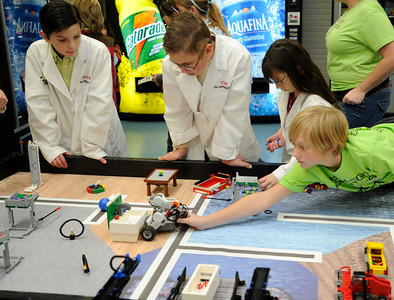 Kids from Sesert Christian Middle School, sponsored by PHI Apprentice and JPL, work get their robots in order. Chaminade College Preparatory Middle School?hosted the LEGO league Food Factor Challenge. The idea was to use robotics and LEGO's to inspire creative thinking in food safety research. Kids dressed  up in costumes, and programmed computer vehicles to automatically drive a field and move objects. Chatsworth, CA 12/16/2011(John McCoy/Staff Photographer)